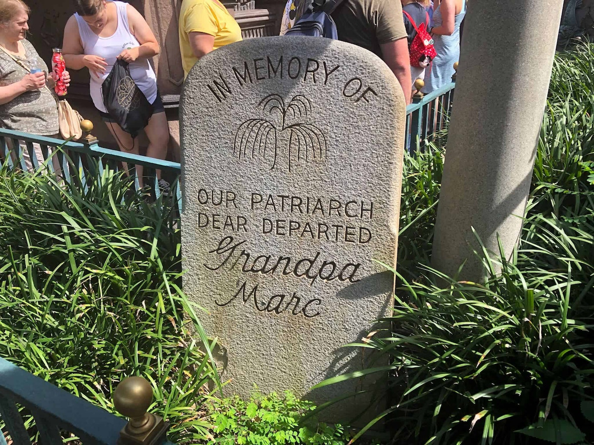 Grandpa Marc Headstone from Haunted Mansion queue