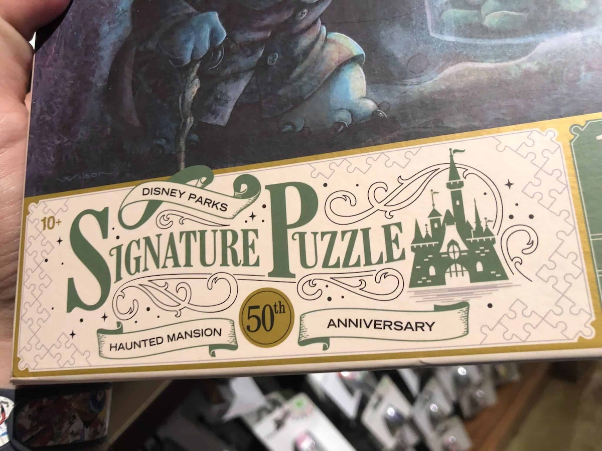 Haunted Mansion 50th Puzzle Released Featuring Stitch as the Hat Box Ghost