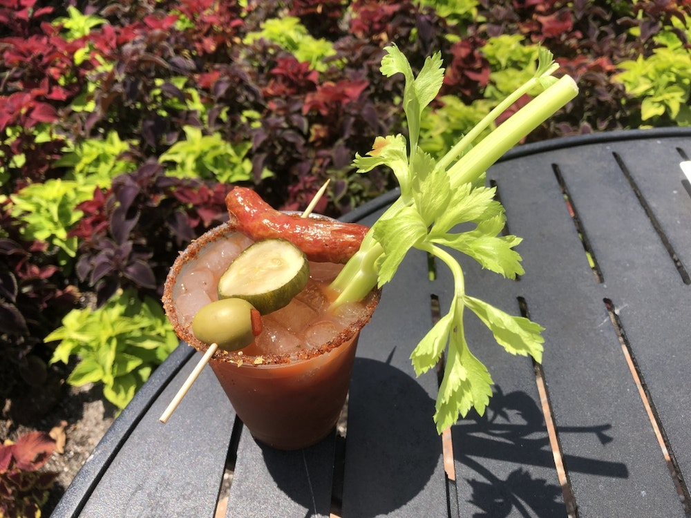 EPCOT Drinks _ Barbecue Bloody Mary with Smoked Garlic Sausage and House-made Pickle Skewer served with a Mustard and Barbecue Rub Rim